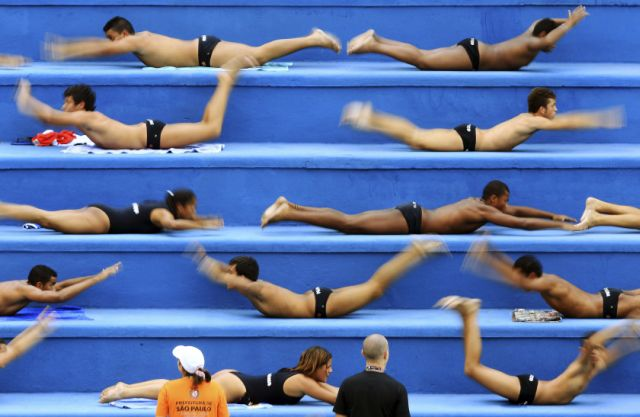 Water polo players warm up before their training in a public swimming pool in Sao Paulo