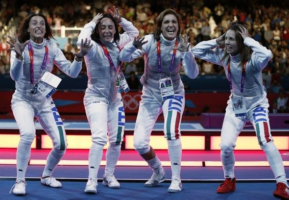 Members of the Italy's fencing team celebrate after winning against Russia in their women's foil team gold medal match during the London 2012 Olympic Games