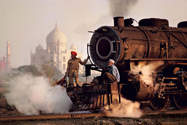Workers move a steam locomotive at the railway yard in Agra, near Taj Mahal, Pradesh, India, 1983